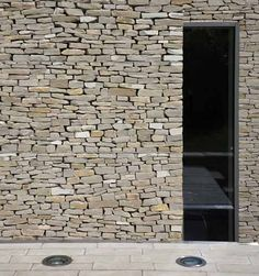nice dry stacked wall detail  Wickstead Lodge by Baynes & Co // Souls & Stones