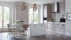 From the herringbone flooring to the golden bar stools, this kitchen is the definition of glamour.