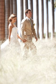 Bride and groom among the palm trees at @Four Seasons Resort Costa Rica.