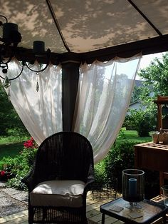 put square tent over porch off of living room.  I like the gauze curtains.