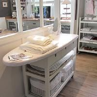 Keep the ironing board out and useful storage...THIS ONE is my favorite ironing board combo that I've seen!