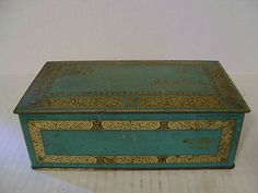 VINTAGE JOHNSTON'S CHOCOLATES HINGED TIN BOX AQUA AND GOLD.             I totally have one of these given to me by my grandma.