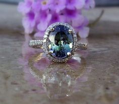 Tanzanite and Diamond ring set in 14kt white gold. This is a natural untreated, unheated Tanzanite in teal blue to purple color set with .27 carats VS diamonds. Stunning! by AleaMariCo, $1045.00