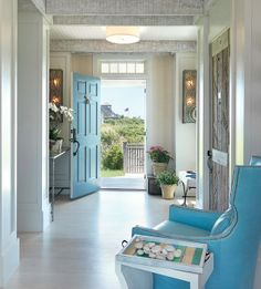 Nantucket goodness ... Aqua front door and wing chair, exposed beams, beadboard ceiling, rustic closet door