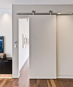 Installing interior barn door hardware can transform the look of your room. Read these steps in buying interior barn door hardware. Barn Door Track System, Sliding Barn Door Track, Sliding Doors, Entry Doors, Front Doors, Sliding Wall, Front Entry, Patio Doors, Garage Doors