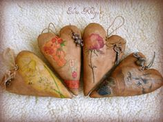 Beautiful hearts tutorial -- it is in Russian I think, but there are lots of photos that SHOW you what to do. These are stuffed and then the images are placed on them etc etc...like decopage`.
