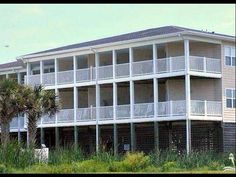 Enjoy ocean views from this comfortable 3 bedroom 2 bath condo with established rental income. The spacious deck overlooking the pool and hot tub has room for dining. HOA dues on this lovely condo include building  flood insurance water and sewer. This home is an easy stroll to the beach or to local dining and shopping. See everything Oak Island has to offer with miles of sandy beach 18 hole golf course nature center piers and marinas.