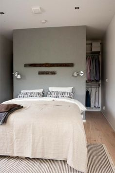 Closet behind the bed -- great solution to my tiny closet and huge bedroom