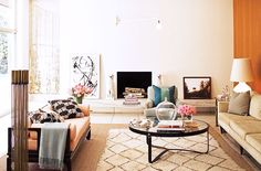 I like the round table, the rug, and the way things are organized especially at the back of the room