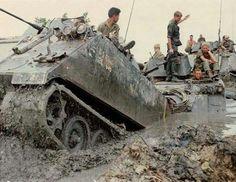 M113s in deep mud. ~ Vietnam War