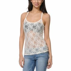 For that extra layer of fun texture wear the Ivory White Lace Cami tank top from Trillium over your bright bikini top, bandeau, or tank. This fitted racerback tank top has an all-over floral lace pattern and racerback straps perfect for lounging around the house or wearing out over a colorful top and paired with shorts or jeans.