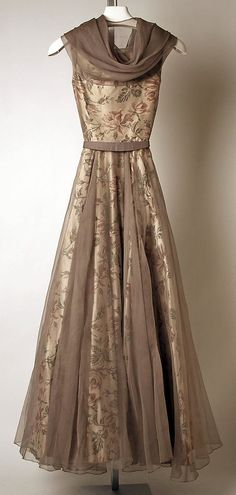 Drape cowl neck 1953 dress of sheer overlaid on floral in gold and mocha tones. Madame Grès of Paris.