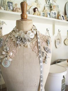 A beautiful vintage mannequin with lace applique, pearls and buttons