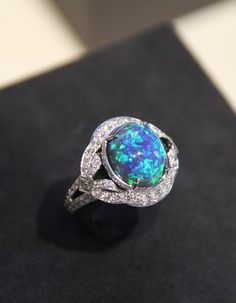 Louis Vuitton one of a kind Conquêtes ring with an 5.07 carat black opal and diamonds.