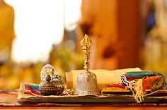 Geshe-la's vajra, bell, damaru and other ritual items. The vajra and bell are made of solid silver and solid gold, gifts from his students.