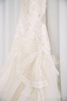 Stunning ruffled lace Yolan Cris wedding dress: http://www.stylemepretty.com/2016/05/24/laid-back-cocktail-hour-wedding/   Photography: Ozzy Garcia - http://ozzygarcia.com/