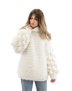 """The authentic """"Cuddle Up"""" is a high neck style, oversized sweater-dress with the world's known statement bubble sleeves. This is a long style jumper created by fine soft yarns. Wear it over jeans, leggings, bell pants, skirt or even as a dress. Big and comfy is the way to go!  This is a 100% Handmade piece in Greece. Please note that this unique item is being knitted by order and it is a one-size, oversized, heavy knit."""