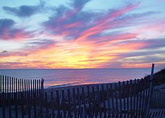 The sun setting over Madaket beach, Nantucket. Located at the far western end of the island, Madaket is a popular beach, especially for watching incredible sunsets like this.