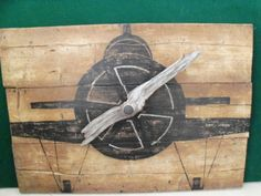 Plane on reclaimed wood with drift wood propeller