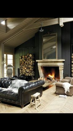 Stacked wood and couch.