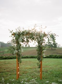 Beautiful Greenery Ceremony Backdrop via Once Wed