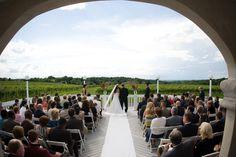 Wedding ceremony at Casa Larga Vineyards on the deck overlooking the vineyard. Reception indoors in Bella Vista events facility. The best of both worlds!  Photo taken by Danielle Zielinski  www.casalarga.com/weddings