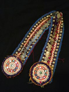 Tribal Kuchi Belt with Medallions Decorated with beads, coins and domes. Belt measures 30 inches long and 3 inches long.