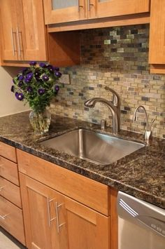 Colors for countertop and back splash in kitchen...    bye bye blue counters. Similar cabinet color to ours.