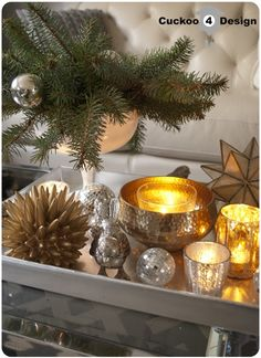 gold and silver Christmas coffee table decor- I like this, but I would simplify it. Coffee Table Vignettes, Coffee Table Tray, Cool Coffee Tables, Decorating Coffee Tables, A Table, Gold Table, Coffee Decorations, Christmas Coffee, Silver Christmas