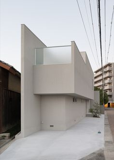 Built by FORM   Kouichi Kimura in , Japan with date 2010. Images by Takumi Ota. This house is built on the triangle site with a width of 18 m. The client has requested to make the best use of the...