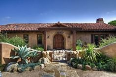 mediterranean exterior by EB Knight Construction