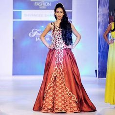 Navneet Kaur Dhillon, Miss India 2013, showcases a creation by designer Shivangee Sharma during a fashion show at the Rajasthan Fashion Week (RFW) 2013 in Jaipur on May 11, 2013.