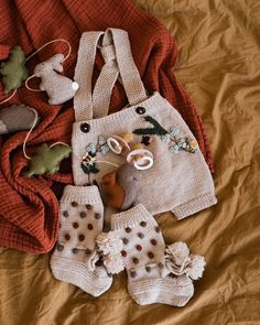 made this cute photo of our baby must haves, including the knitted footies and these adorable suspender shorts in colour nude! This would be such a cute baby outfit, don't you think? Baby Outfits, Weekender, Knitted Booties, Kids Fashion Boy, Rust Color, Colour, Baby Socks, Cute Baby Clothes, Cute Photos