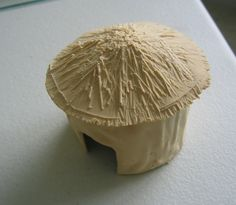 Miniature thatched roof huts using Durham's water putty. For how-to instructions visit:   http://solipsistgaming.blogspot.com/2011_07_01_archive.html