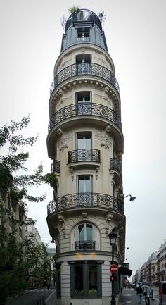 Beautiful building in Paris with a garden on top.