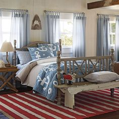 Beach House Bedroom with anchor reversible quilt set (solid blue on the back), adorable wave print sheets, Yacht strip window panels, Red Paddle Stripe rug, Spinnake Lamp & a light bark colored frame Duvet.