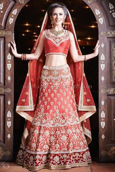 Indian Wedding Outfit - Red raw silk heavily embroidered 8 panel lengha with diamante and jardosi work.  2015 collection, ideal for a Sikh or Punjabi wedding.