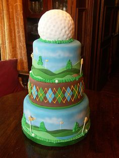Golf Tournament Cake - A cake my sister & I made for a local Golf Tournament. Airbrushed gradient sky and clouds. Everything else is fondant and royal icing. The flag poles are lollipop sticks. It was pretty fun to make :)