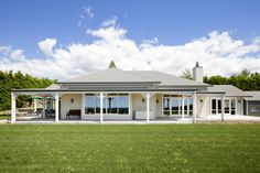 Faithful to the style of the era, only the materials are 21st Century: Timber weatherboard, longrun iron, verandah fretwork, plus solid timber sills and frames that merge seamlessly with aluminium joinery.