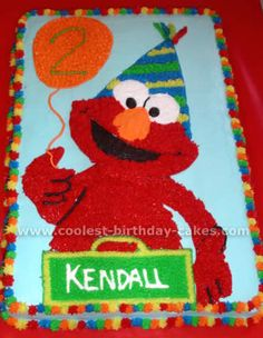 Cake: printing a picture of Elmo off the internet, and then I blew it up and traced him onto wax paper.    I then cut him out and placed him on my iced sheet cake and traced around him with a toothpick. Then I filled him in.