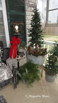 best holiday home tour everpart 2 potted christmas treeschristmas porch ideaschristmas - Primitive Christmas Porch Decor