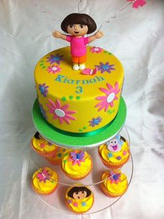 Simple n Sweet Dora cake (with matching cupcakes) - Cake by Mardie Makes Cakes