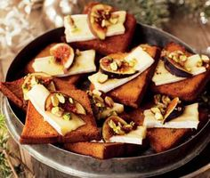 Toasted gingerbread with brie and fresh figs and roasted pine nuts.