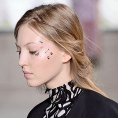 We're calling it now—temporary face tattoos will be everywhere at Coachella