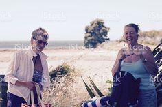Senior Ladies on Beach Laughing royalty-free stock photo