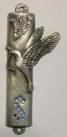 This beautiful pewter mezuzah makes a great gift as it can be personalized with an initial of your choice. The initial is made with genuine Swarovski crystal rhinestones. The cavity of the mezuzah is
