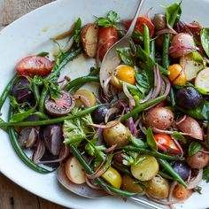 Food & Wine's best-ever Italian salad of tomatoes, haricots verts and potatoes is the perfect summer cookout dish.