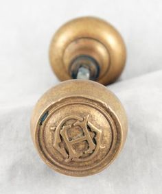 Brass emblematic knob set