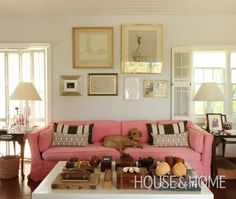 """""""Use metallic frames to glamourize artwork. A collection of found objects precisely placed on the sitting room's coffee table acts as artwork. While symmetrical furniture placement lends a touch of formality, the pink sofa recalls the tropical setting."""" Hibiscus Hill, Bahamas. Design by India Hicks and David Flint Wood. Photo Gallery: Rooms To Inspire By The Sea (Annie Kelly, Rizzoli) 