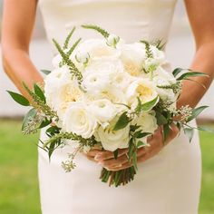 Romantic White Bridal Bouquet - Love the soft greenery poking out...not the leaves as much.